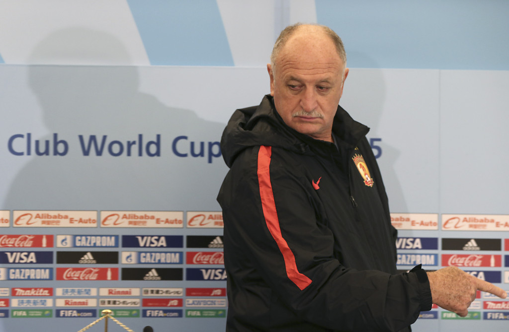 Guangzhou Evergrande FC's coach Luiz Felipe Scolari of Brazil gestures as he arrives a press conference venue at the FIFA Club World Cup soccer tournament in Osaka, western Japan, Saturday, Dec. 12, 2015. Club America and Guangzhou Evergrande will play in their quarter final match at the tournament on Sunday. (AP Photo/Eugene Hoshiko)