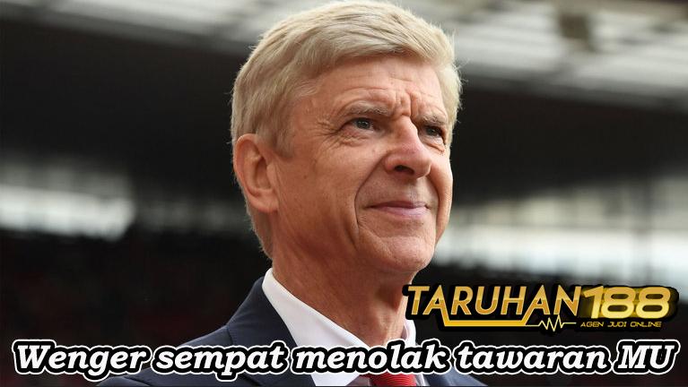 Wenger sempat menolak tawaran MU